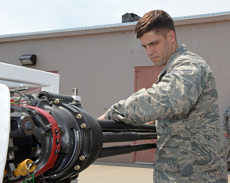 Senior Airman Daniel Fox, 9th Civil Engineer Squadron Explosive Ordinance Disposal Technician, disassembles M61 Vulcan 20 mm rotary cannon as part of training at Kingsley Field Air National Guard Base, Oregon, July 30, 2015. The training was conducted by the 173rd Fighter Wing for Fox and other members of the 9th CES EOD flight. (U.S. Air Force photo by Airman 1st Class Ramon A. Adelan)