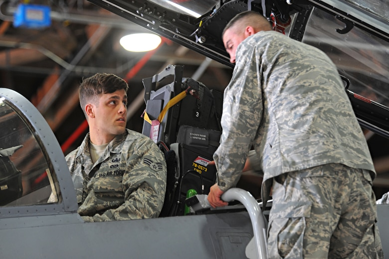Senior Airman Daniel Fox (left), , receives hands on egress training on an F-15 Eagle from Tech. Sgt. Brent Hublitz, 173rd Fighter Wing egress ordnance technician, at Kingsley Field Air National Guard Base, Oregon, July 30, 2015. Beale's EOD received hands on training and provided safety support for Sentry Eagle 15 July 30 to Aug. 2, 2015. (U.S. Air Force photo by Airman 1st Class Ramon A. Adelan)