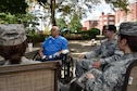 Kingsley Carey, a former Tuskegee Airman, speaks with members of the 911th Airlift Wing outside of a nursing home in Pittsburgh, Pa., Aug. 1, 2015. Carey, who is now 98 years-old, shared both good and bad memories so that the current generation of Airmen could benefit from his experience. (U.S. Air Force photo by Staff Sgt. Joshua J. Seybert)