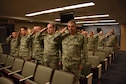 Members of the 911th Operations Support Squadron render their first salute to the new squadron commander in an assumption of command ceremony at the Pittsburgh International Airport Air Reserve Station, August 1, 2015. Lt. Col. Jennifer Fitch, 911th OSS commander, assumed command of the squadron during the August unit training assembly. (U.S. Air Force photo by Senior Airman Marjorie A. Bowlden)