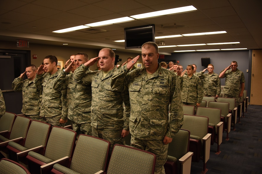 Members of the 911th Operations Support Squadron render their first salute to their new squadron commander in an assumption of command ceremony at the Pittsburgh International Airport Air Reserve Station, August 1, 2015. Lt. Col. Jennifer Fitch, 911th OSS commander, assumed command of the squadron during the August unit training assembly. (U.S. Air Force photo by Senior Airman Marjorie A. Bowlden)