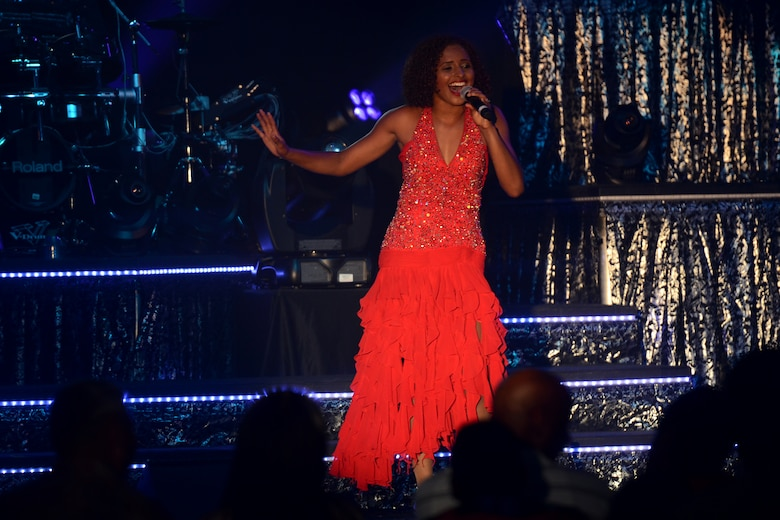 2nd Lt. Nicque Robinson, Tops in Blue vocalist, performs during a show at the Coral Reef Fitness Center Aug. 1, 2015, at Andersen Air Force Base, Guam. More than 700 people attended the show which had a set list of many current popular songs and a hit song from each decade spanning from 1910 to 1990. (U.S. Air Force photo by Airman 1st Class Alexa Ann Henderson/Released)
