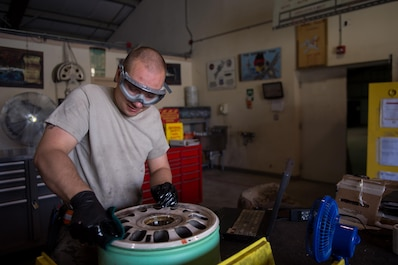 "U.S. Air Force Staff Sgt. William ""Willy"" Reibsome III, 455th Expeditionary Maintenance Squadron wheel and tire noncommissioned officer in charge, cleans and inspects an F-16 Fighting Falcon aircraft wheel at Bagram Airfield, Afghanistan, Aug. 2, 2015. Reibsome ensures that F-16s at BAF have serviceable tires to complete the combat airpower mission; on average he works 70 wheels per month. (U.S. Air Force photo by Tech. Sgt. Joseph Swafford/Released)"