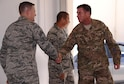 From left, Chief Master Sgt. Scott Smith, 353rd Special Operations Maintenance Squadron superintendent, greets Command Sgt. Maj. William Thetford, U.S. Special Operations Command senior enlisted leader, during a visit July 29, 2015 at Kadena Air Base, Japan.  During his visit to the 353rd Special Operations Group, Thetford visited with the Airmen as they provided displays to show Thetford first-hand what the Special Operations Airmen do in the Indo-Asia Pacific region.  (U.S. Air Force photo by Tech. Sgt. Kristine Dreyer)