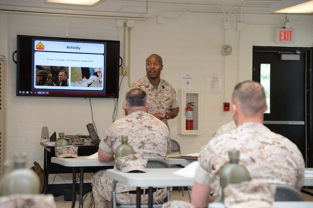 Sgt. Maj. Gary Smith, 4th Marine Logistics Group, New Orleans, Louisiana, addresses corporals attending the two-week Corporal's Course at Marine Corps Logistics Base Albany, recently. Smith urged corporals to exclude the 'deadly vowels:' (A-E-I-O-U), when setting their foundation as leaders: 'A' is arrogance; 'E' is ego; 'I' is individual; 'O' is the one, and 'U' is unapproachable. The training was conducted as part of the noncommissioned officers' Professional Military Education on leadership.
