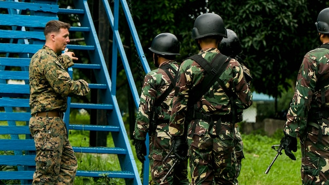 U.S. Marine Corps Sgt. Brent Maholy supervises a group of Philippine airmen as they climb a 40-foot tower to begin fast roping during Air Assault Support Exercise 2015-2 on Basa Air Base in Pampanga, Philippines, July 15, 2015. The exercise is a bilateral training event focused on strengthening the alliance between the Philippines and the U.S. Maholy is a squad leader with 2nd Platoon, Fox Company, 2nd Battalion, 3rd Marines and is attached through the Unit Deployment Program to III Marine Expeditionary Force. The Philippine airmen are with Ground Special Operations Unit, 710th Special Operations Wing, Philippine Air Force.