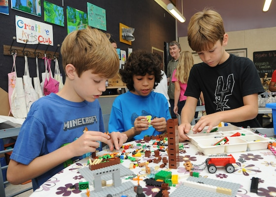 Davis Chancey, Miguel Heredia and Mason Chancey create a stop motion animation movie July 28 during Geekbus at the Joint Base San Antonio-Randolph Youth Center.