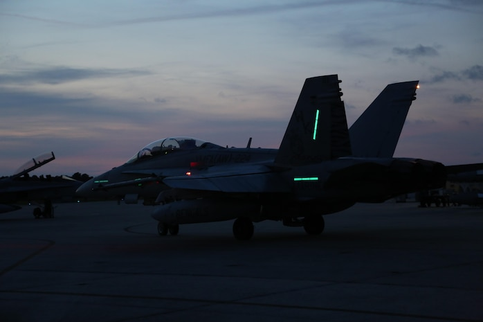 A F-A/18D Hornet taxis down the runway aboard Marine Corps Air Station Beaufort July 30. The jet is preparing to execute a night flight as part of  the Palmetto Fire Exercise. The exercise is a joint service exercise utilizing Marine Corps, Navy, and Air Force aircraft. The aircraft is a part of Marine All-Weather Fighter Attack Squadron 224, Marine Aircraft Group 31. (U.S. Marine Corps photo by Lance Cpl. Samantha K. Torres/released)