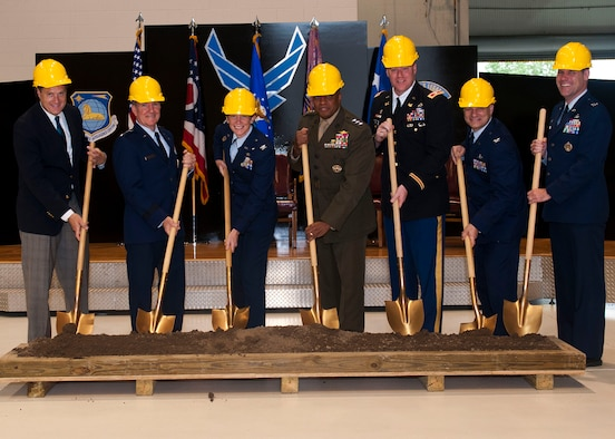 """From left to right, Michael Turner, congressman, Gen. Herbert """"Hawk"""" Carlisle, Air Combat Command commander, Col. Leah Lauderback, National Space Intelligence Center commander, Lt. Gen. Victor Stewart, Defense Intelligence Agency, Col. Christopher Beck, U.S. Army Corps of Engineers Louisville District commander, Col. Brian May, Air Force Civil Engineer Center director , Col. John Devillier, 88th Air Base Wing commander, break ground at the foreign material exploitation facility's groundbreaking ceremony Friday June 19, 2015. The $30 million, 58,000 square-foot addition will nearly triple the size of the existing facility, and doubles the lab space, enabling NASIC to execute the ever-increasing number of projects protected at higher classification levels. (U.S. Air Force photo by Airman 1st Class Samuel Earick)"""