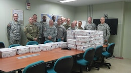 U.S. Army Corps of Engineers Far East District Soldiers received care packages Aug. 4, 2015 from the Oklahoma Blue Star Mothers of America, Inc. Blue Star Mothers of America have over 6,000 members from over 200 Chapters throughout the nation. They are mothers, stepmothers, grandmothers, foster mothers and female legal guardians who have children serving in the military, guard or reserves, or children who are veterans.