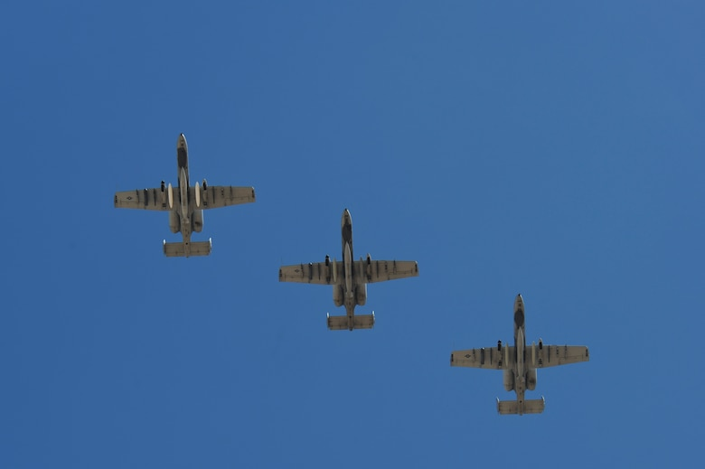 Three U.S. Air Force A-10C Thunderbolt IIs from the 354th Fighter Squadron fly in formation over Davis-Monthan Air Force Base, Ariz., Aug. 4, 2015. Twelve A-10s and their pilots from the 354th FS returned after a 6-month-long deployment to Europe where they flew over 1,500 missions throughout 21 countries as part of the Theater Security Package to Europe in support of Operation Atlantic Resolve. (U.S. Air Force photo by Senior Airman Chris Massey/Released)