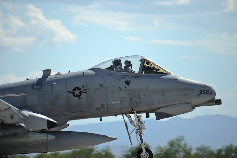 A U.S. Air Force A-10C Thunderbolt II from the 354th Fighter Squadron touches down on the runway at Davis-Monthan Air Force Base, Ariz., after returning from a 6-month deployment, Aug. 4, 2015. While deployed, the 354th Fighter Squadron participated in 21 exercises, compiling more than 1,500 flying missions and nearly 2,700 flight hours while engaging with 22 countries. (U.S. Air Force photo by Senior Airman Chris Massey/Released)
