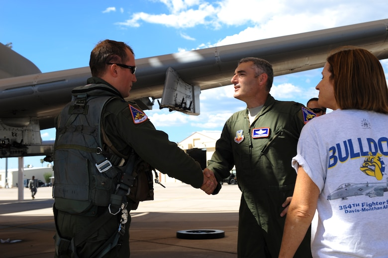 U.S. Air Force Col. Stephen Renner, 355th Fighter Wing vice commander, greets Lt. Col. Ryan Hayde, 354th Fighter Squadron commander,on the flightline at Davis-Monthan Air Force Base, Ariz., after Hayde returned from a deployment August 4, 2015.Twelve A-10s and their pilots from the 354th FS returned after a 6-month-long deployment to Europe where they flew over 1,500 missions throughout 21 countries as part of the Theater Security Package to Europe in support of Operation Atlantic Resolve. (U.S. Air Force photo by Airman 1st Class Chris Drzazgowski/Released)