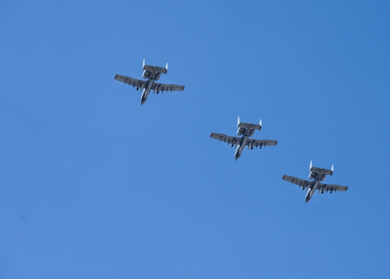 Three A-10C Thunderbolt II aircraft prepare to land at Davis-Monthan Air Force Base Ariz., Aug. 4, 2015, after a 6-month long deployment. A-10s possess a wide combat radius and allow for a short takeoff and landing capabilities aiding in missions in and out of locations near front lines. (U.S. Air Force photo by Airman 1st Class Ashley N. Steffen/ Released)