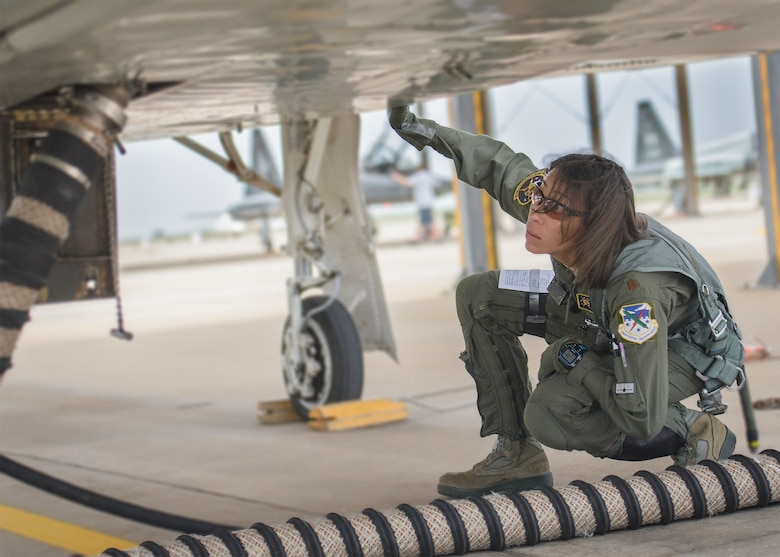 Maj. Christina Hopper conducts a comprehensive check of her T-38 Talon on the flightline at Vance Air Force Base, Oklahoma, July 20. (U.S. Air Force photo / David Poe)