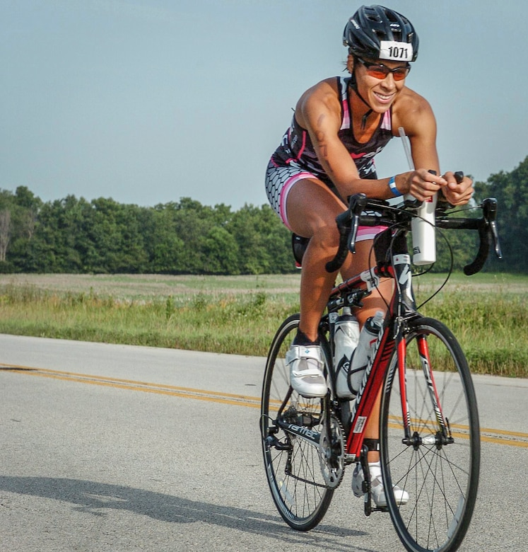 Maj. Christina Hopper bikes during the Ironman 70.3 Muncie at Muncie, Indiana, July 11. Hopper completed her 56-mile bike ride in 2:44:29. (Courtesy photo / finisherpix)