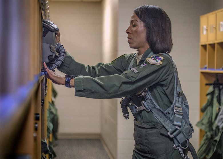 Maj. Christina Hopper, a 5th Flying Training Squadron instructor pilot, preps for an upcoming instruction flight at the life support building at Vance Air Force Base, Oklahoma, July 20. (U.S. Air Force photo / David Poe)