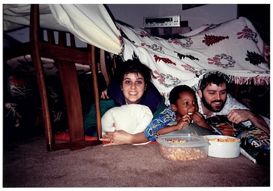 Yvonne Meeder, Christopher Bowyer-Meeder and Bruce Meeder, enjoy popcorn under a home-built blanket fort while watching a movie. Bruce and Yvonne became Chris's legal guardians when he was just five-years-old. (U.S. Air Force courtesy photo)