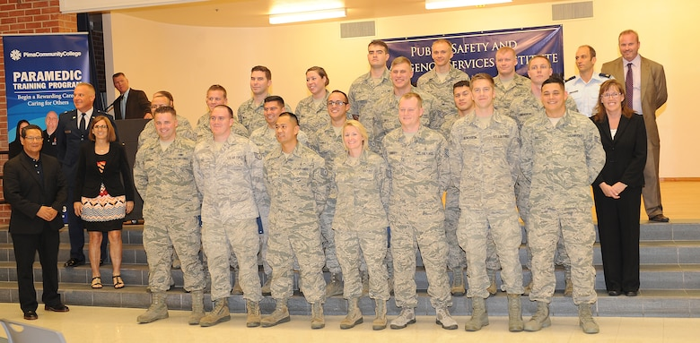 U.S. Air Force Airmen from around the country gather together after graduating the paramedic training course at the Pima Community College Public Safety Emergency and Services Institute, Tucson, Ariz., July 31, 2015. These Airmen went through four months of didactic and field training to become nationally registered paramedics. The PSESI is the only location that Airmen can become nationally certified paramedics. (U.S. Air Force photo by Airmen 1st class Cheyenne Morigeau/Released)