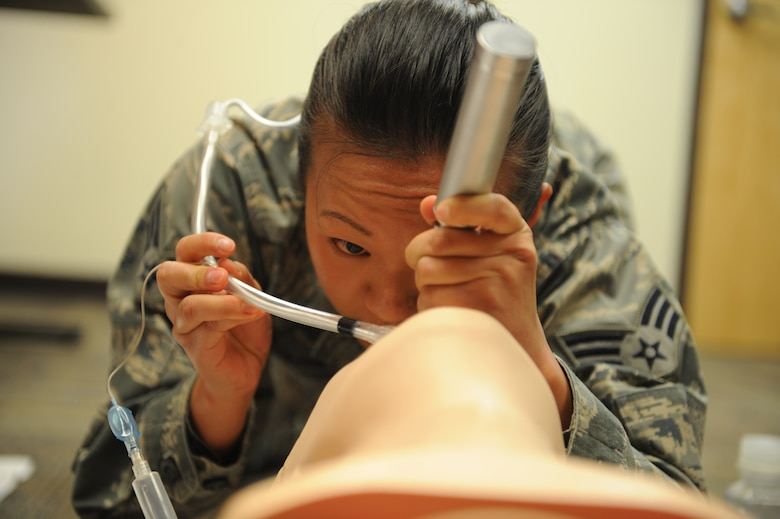 U.S. Air Force Senior Airman Mia Yang, 99th Reconnaissance Squadron Beale Air Force Base Calif., medical technician, performs oral tracheal intubation on a training manikin at Pima Community College Public Safety Emergency and Services Institute, Tucson, Ariz., July 29, 2015. Yang was taking a paramedic training course offered strictly to Airmen through PSESI. Yang and 20 other Airmen were the third class to graduate from the course on July 31. (U.S. Air Force photo by Airmen 1st class Cheyenne Morigeau/Released)