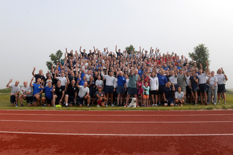 """Members of the 3rd Space Experimentation Squadron and the 50th Space Wing shout """"Fight back Zach!"""" during a photo and video shoot held before the Fight Back 5K Thursday, July 30, 2015 at Schriever Air Force Base, Colorado. Approximately 282 Airmen took part in the run to show their support for Lt. Col. Zachary Owen, 3 SES commander, and his family as he battles cancer. (U.S. Air Force photo/Christopher DeWitt)"""