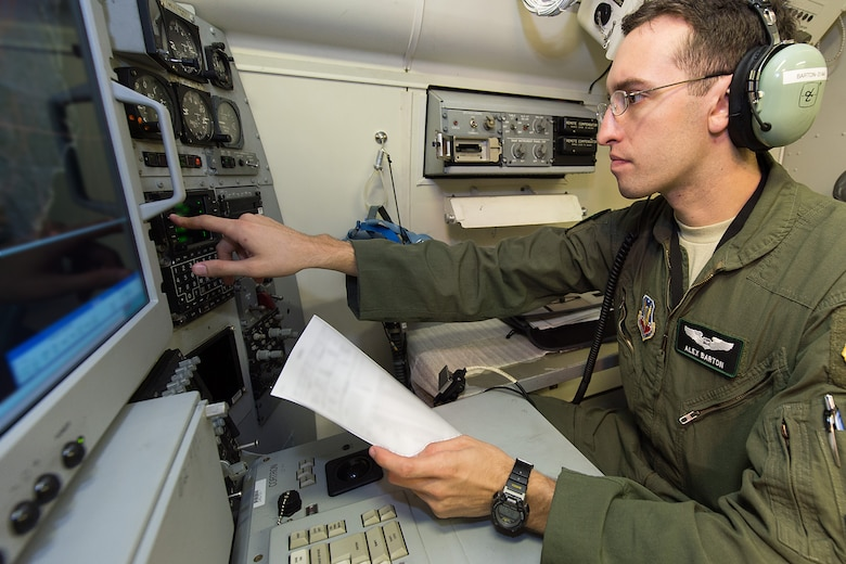 U.S. Air Force 1st Lt. Alex Barton, a navigator with the 12th Airborne Command and Control Squadron, performs a pre-flight ops check on an E-8C Joint STARS in preparation for a mission during the Northern Strike 2015 combat exercise, Robins Air Force Base, Ga., July 29, 2015. Team JSTARS joined military forces from more than 20 states and four coalition countries for the exercise hosted by the Michigan National Guard. Working with a liaison officer from the 116th Air Control Wing (ACW), Georgia Air National Guard, deployed to the exercise headquarters in Michigan, aircrews flying out of Robins Air Force Base from the 461st ACW and the Army JSTARS provided real-time tracking information to air and ground forces helping them to find and identify enemy forces played by exercise participants. (U.S. Air National Guard photo by Senior Master Sgt. Roger Parsons/Released) (Portions of the photo have been blurred for security purposes)
