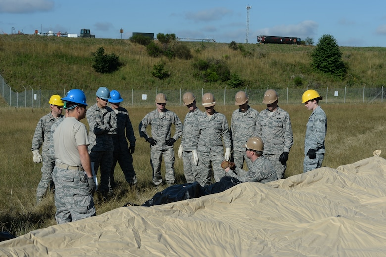 U.S. Air Force Airmen from the 606th Air Control Squadron learn how to build a tent during mobile deployment training July 30, 2015, at Spangdahlem Air Base, Germany. This specific training aims to ensure the 606th ACS can load their equipment, transport it to austere locations and build work centers from the ground up to accomplish the mission. (U.S. Air Force photo by Senior Airman Dylan Nuckolls/Released)