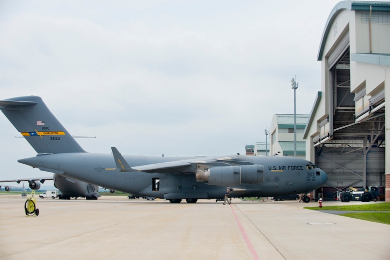 The final C-17 Globemaster III aircraft to be assigned to the 167th Airlift Wing is towed into the corrosion control hangar just after arriving at the Martinsburg, W.Va. air base, July 17. The aircraft was previously flown by airlift wings assigned to Charleston Air Force Base. To finalize the transfer of the aircraft to the 167th Airlift Wing, the C-17 underwent numerous inspections, paperwork updates and the tail flash and unit marking were repainted. (Air National Guard photo by Master Sgt. Emily Beightol-Deyerle/released)