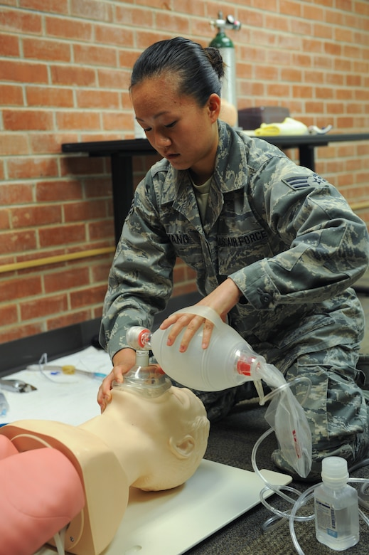 U.S. Air Force Senior Airman Mia Yang, 99th Reconnaissance Squadron Beale Air Force Base Calif., medical technician, uses a bag valve mask on a practice manikin at the Pima Community College Public Safety Emergency and Services Institute, Tucson, Ariz., July 29, 2015. Yang was a student paramedic going through a paramedic training course offered strictly to Airmen at PSESI. (U.S. Air Force photo by Airmen 1st class Cheyenne Morigeau/Released)