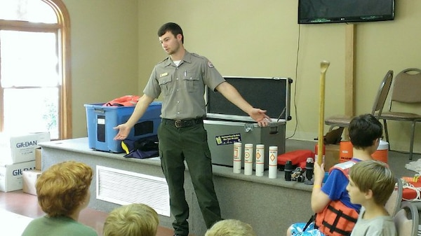 Center Hill Lake's Summer Ranger Dylan Hamlet talks with kids at Lighthouse Christian Camp July 7, 2015.  He visited the camp in Smithville, Tenn., each week and educated hundreds of campers on the importance of water safety.