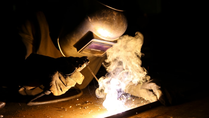 U.S. Marine Sgt. Arnet Moore, a welder with the Logistics Combat Element, Special Purpose Air-Ground Task Force-Crisis Response-Central Command, welds a piece of metal for a project in Southwest Asia, July 19, 2015.