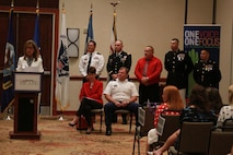 Local Community and armed services leaders stand before the crowd after signing the Common Ground Compact July 29, 2015, at the Waterfront Convention Center in Morgantown, West Virginia.  The compact is a combined effort between the Department of Education and the military to reduce the high school dropout rate and ensure students across West Virginia are career and college ready. (U.S. Marine Corps photo by Sgt. Caitlin Brink/Released)