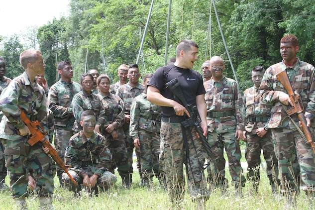 U.S. Marine Corps Staff Sgt. Justin E. Thurber, from Shawnee, Kansas, shows Air Force Junior Reserve Officer Training Corps cadets how to lead a patrol during the AFJROTC Chantilly Academy Cadet Leadership Course on Joint Base Andrews Naval Air Facility Washington, June 25, 2015. Thurber is staff noncommissioned officer in charge of Recruiting Station Frederick Recruiting Sub-station Chantilly. (U.S. Marine Corps photo by Sgt. Anthony J. Kirby/Released)