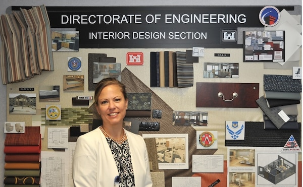 Patricia Mooneyham, a chief in the Interior Design Section, at the Engineering and Support Center, Huntsville, stands in front of an interior design sample board Wednesday, which was designed by several interior designers. Mooneyham will be presented with the U.S. Army Corps of Engineers 2015 Interior Designer of the Year award in August at the Huntsville Center.