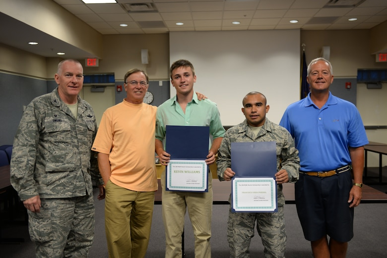 WESTHAMPTON BEACH, NY - Col Thomas J Owens and Col Robert Landsiedel (retired) awards Senior Airman Francisco Vierapereira, of the 106th Civil Engineering Squadron and Kevin William, son of MSgt (Ret.) Don Williams the Alumni Association Scholarship at FS Gabreski ANG on August 05, 2015.