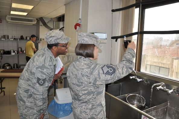 Master Sgt. Tanya Jacquez, 425th Air Base Squadron Medical Aid Station flight chief, and Tech. Sgt. Robert Wilson, 425th ABS Medical Aid Station NCO in charge, test water for chlorine levels in the Izmir Club water. (U.S. Air Force photo by Tanju Varlikli)