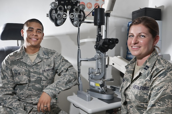Senior Airman Adlai Ceja and Capt. Lauren Matthews are Airmen that work in the 379th Expeditionary Medical Group optometry clinic here at Al Udeid Air Base, Qatar. As a two person team, they ensure both deployed and permanent party service members and dependents receive proper eye care while away from home station or stateside facilities. (U.S. Air Force photo/Staff Sgt. Alexandre Montes)