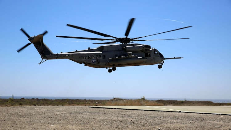 A CH-53E Super Stallion assigned to Marine Heavy Helicopter Squadron 361, 3rd Marine Aircraft Wing, prepares to land before transporting Marines with 3rd Battalion, 5th Marine Regiment, 1st Marine Division, as part of the Marine Corps Combat Readiness Evaluation (MCCRE), aboard Marine Corps Base Camp Pendleton, California, Aug. 4, 2015. The MCCRE is used evaluate the operational readiness of a designated unit.