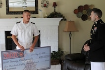 Tomasz Niedzwiecki, left, talks with U.S. Marine Corps Capt. Joseph M. Depew, former Recruiting Station Cleveland Executive Officer, after being awarded the Naval Reserve Officers Training Corps Scholarship June 19, 2015 at Niedzwiecki's home. Applicants compete nationwide for the NROTC Scholarship valued at $180,000.  Niedzwiecki is a midshipman in the NROTC program at Miami University (Ohio) studying mechanical engineering.  (U.S. Marine Corps photo by Sgt. Stephen D. Himes/Released)