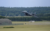 An F-15E Strike Eagle assigned to the 492nd Fighter Squadron takes off from Royal Air Force Lakenheath, England, July 28, 2015. The 48th Fighter Wing produces an average of 32 sorties throughout the day to maintain training requirements. (U.S. Air Force photo/Senior Airman Trevor T. McBride)