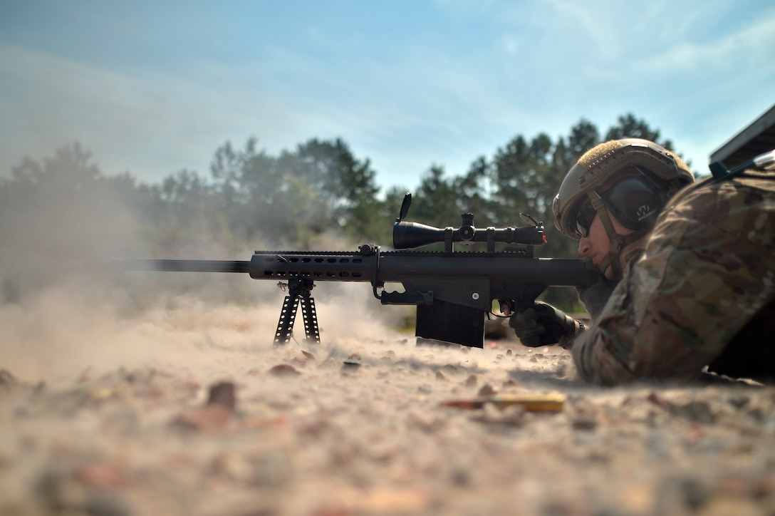 Staff Sgt. Carlos Butriago trains with a Barrett sniper rifle at the Suffolk County firing range in Westhampton Beach, N.Y., July 27, 2015. Butriago is a member of the 106th Security Forces Squadron. (U.S. Air National Guard photo/Staff Sgt. Christopher S. Muncy)