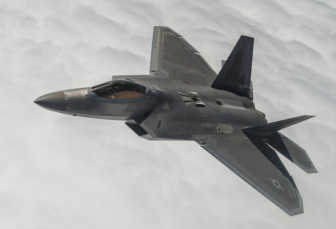 An F-22A Raptor from the 95th Fighter Squadron at Tyndall Air Force Base, Fla., flies over the Nevada Test and Training Range during Red Flag 15-3 at Nellis AFB, Nev., July 31, 2015. Red Flag gives aircrews and air support operations service members from various airframes, military services and allied countries an opportunity to integrate and practice combat operations. (U.S. Air Force photo/Senior Airman Brittany A. Chase)