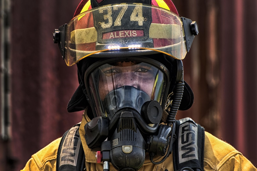 Staff Sgt. Trevor Alexis, a 374th Civil Engineer Squadron fire protection NCO in charge of training, waits to enter a flashover trainer Aug. 4, 2015, at Yokota Air Base, Japan. Flashover, a near-simultaneous ignition of many objects in a confined room, creates a dangerous situation where both heat and smoke continue to increase until combustion. Simulating a flashover fire in a confined room with limited ventilation, enables a trainer to educate and prepare firefighters to recognize and react to a potentially dangerous situation. (U.S. Air Force photo/Airman 1st Class Delano Scott)