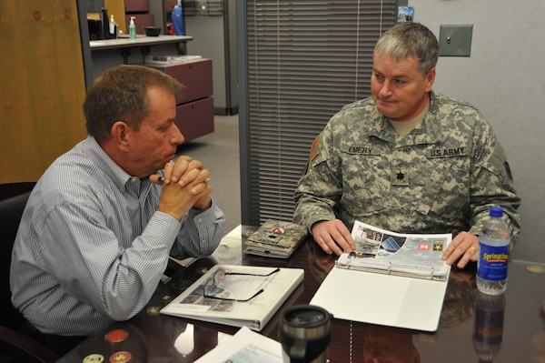 """Lieutenant Col. Burlin L. Emery, deputy commander of the U.S. Army Engineering and Support Center, Huntsville met with Albert """"Chip"""" Marin, director of the Huntsville Center's Installation Support and Programs Management Directorate and ISPM division chiefs, for an inbrief on ISPMs mission. Emery has been visiting Huntsville Center's numerous directorates and small offices since his arrival to better understand its diverse mission."""