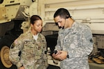 Spc. Tara Morrison (left) and Pfc. Brian Hollenbeck, both with Headquarters Support Company, U.S. Army Africa, test the SQ.410 Translation System in Vicenza, Italy.