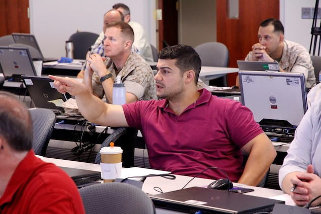 Michael Martha, systems engineer with Light Tactical Vehicles in Program Executive Officer Land Systems, asks a question during the modeling and simulation course held in July at Marine Corps Base Quantico, Virginia.