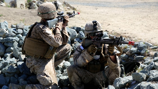 Marines with 3rd Battalion, 5th Marine Regiment, 1st Marine Division, establish security during a helicopter raid, as part of the Marine Corps Combat Readiness Evaluation (MCCRE), aboard Marine Corps Base Camp Pendleton, Calif., Aug. 4, 2015. The MCCRE is used evaluate the operational readiness of a designated unit.