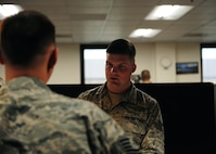 Senior Airman Mason Meherg, 509th Comptroller Squadron financial services technician, in-processes a customer June 18, 2015, at Whiteman Air Force Base, Mo. Meherg was recently named one of 12 Outstanding Airmen of the Year for 2015. (U.S. Air Force photo by Senior Airman Joel Pfiester/Released)