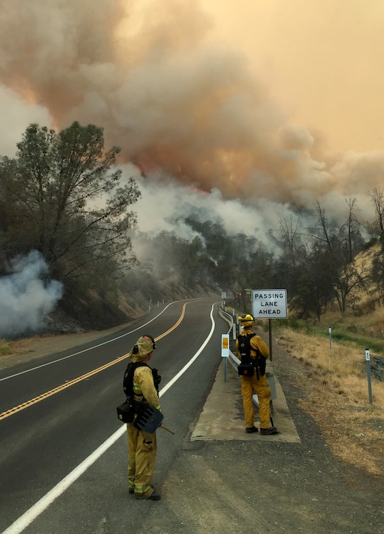 Firefighters survey the Rocky Wildfire, Aug. 2, 2015, near Clearlake, California. (Courtesy photo)