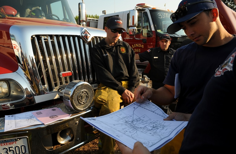 Steven Dobbs, 9th Civil Engineer Squadron fire captain, views a map of terrain near Clearlake, California to help combat a wildfire, Aug. 6, 2015, in Lakeport, California. The Rocky Wildfire has consumed nearly 70,000 acres in Northern California. (U.S. Air Force Photo by Airman Preston L. Cherry)